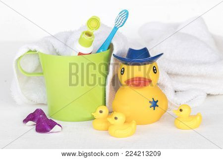 toothbrush toothpaste and duck toy for health care oral cavity of children on white