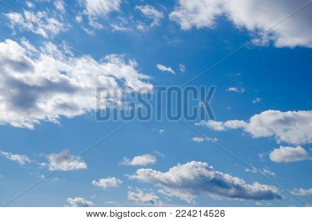 blue sky with stratocumulus and cumulus clouds on a summer day