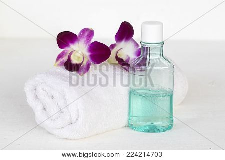 mouthwash with towel cloth for health care oral cavity on white