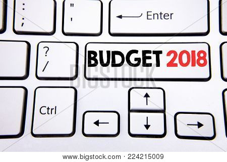 Hand writing text caption inspiration showing Budget 2018. Business concept for Household budgeting accounting planning written on white keyboard key with copy space. Top view