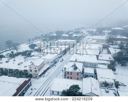 Aerial view of small town in snowstorm.