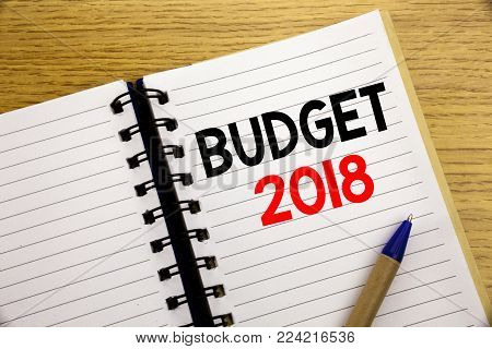 Word, writing Budget 2018. Business concept for Household budgeting accounting planning written on notepad with space on old wood wooden background with pen marker