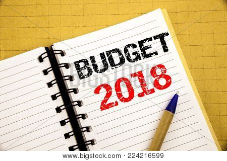 Budget 2018. Business concept for Household budgeting accounting planning written on notepad with space on old wood wooden background with pen marker