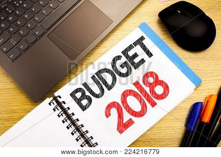 Handwritten text caption showing Budget 2018. Business concept writing for Household budgeting accounting planning written on notepad with space on old wood wooden with pen computer
