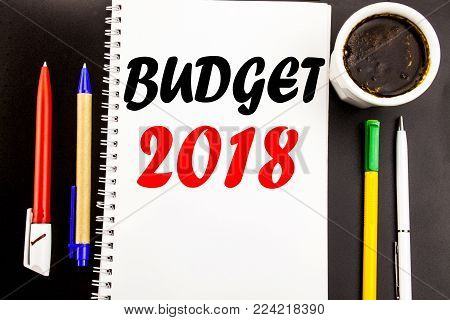 Writing text showing Budget 2018. Business concept for Household budgeting accounting planning Written on notepad paper background with space office view with pencil marker coffee