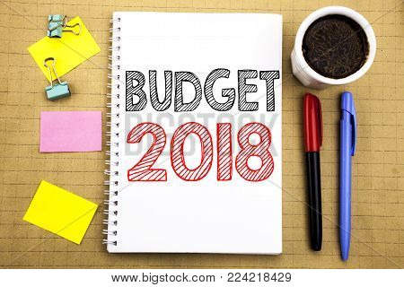 Word, writing Budget 2018. Business concept for Household budgeting accounting planning Written on notepad paper background with space office view with pencil marker coffee