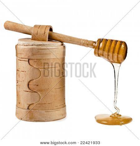 honey and honey stick  isolated on white