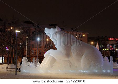 Perm, Russia-January 16, 2018: Street of Lenin in the city of Perm is decorated with a snow sculpture Russian bear.