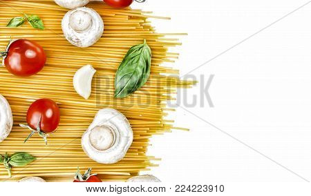 Vegetarian food. Authentic Italian raw pasta and accompanying ingredients: cherry tomatoes, mushrooms, basil and garlic.
