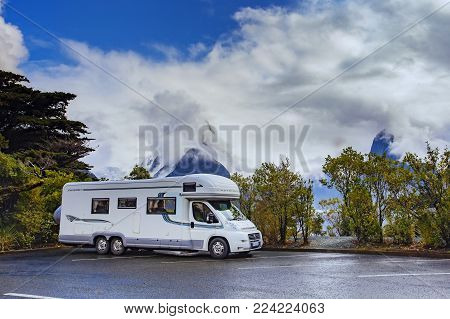 MILFORDSOUND NEW ZEALAND - AUGUST 30,2015 : camper van parking in park lot of milford sound fiordland national park most popular traveling destination in southland new zealand