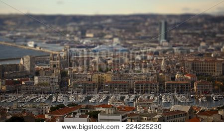 Urban Panorama, Aerial View, Cityscape Of Marseille, France. Tilt shift effect.