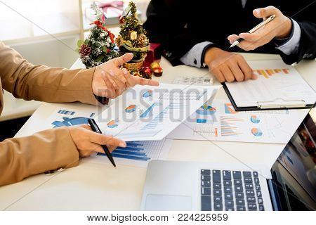 Group Of Angry Business People Blaming Male Colleague In Meeting For Business Mistake In Office.