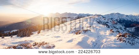 Mountain snowy landscape at sunset. West italian Alps.