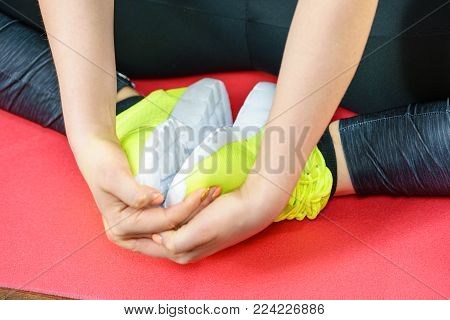 Woman wearing sportswear trainers red shoes, comfortable footwear perfect for workout and training.