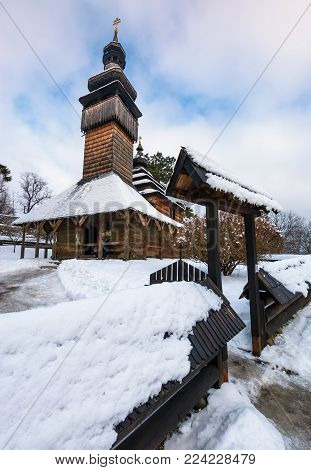 Uzhgorod, Ukraine - JAN 15, 2017: old orthodox wooden church in winter. location Museum of Folk Architecture and Life.