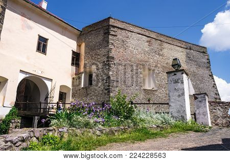 Mukachevo, Ukraine - MAY 25, 2008: entrance with bridge of the Palanok Castle. Old fortification now serves as the museum and is popular tourist landmark