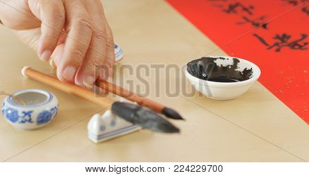 Dipping black ink for writing Chinese calligraphy
