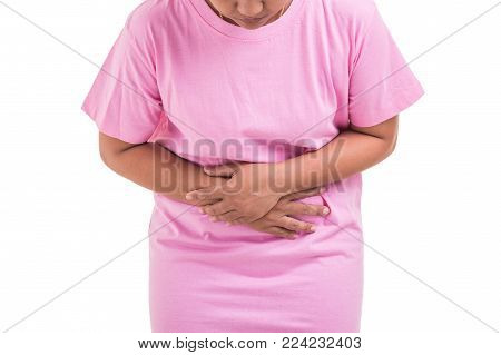 Stomach Ache / Pain Concept: Woman Using Her Hand And Pressing On Stomach Isolated On White