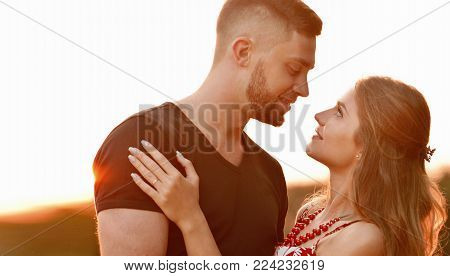 Happy Young Couple Hugging And Laughing Outdoors