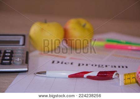 Healthy natural organic food diet, ripe harvest. Fruit composition, measuring tape, calculator with diet plan. Dieting concept