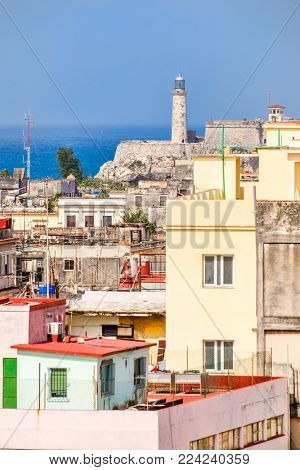 The famous Morro lighthouse and a view of old buildings in Havana