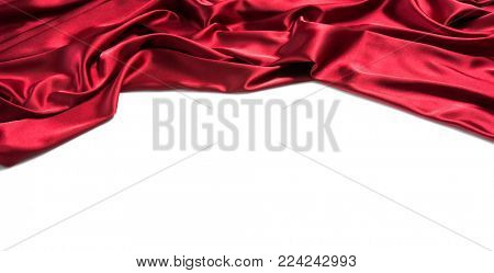 Red silk drapery. Copy space for text. Isolated on white background