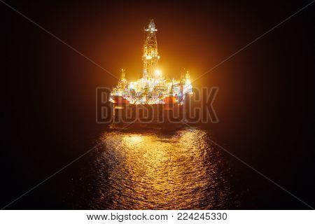 offshore oil platform at night