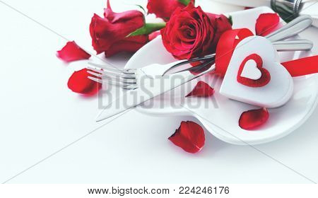 Romantic table setting on white table. Valentine's day card template