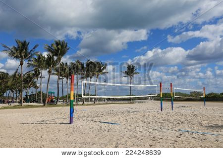 Parks fun of walking and biking trails as well as volleyball nets abound in Miami Beach, Florida along Ocean Drive.