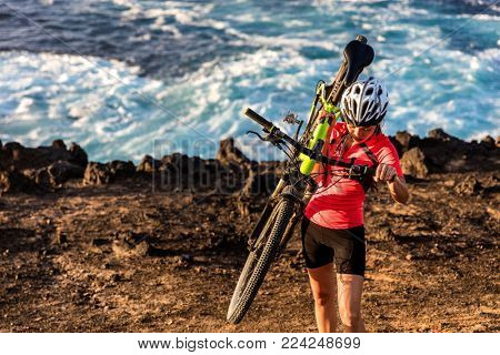 Mountain biking carrying bike uphill walking up hill. MTB biker cyclist riding outdoors. Cycling sports. poster
