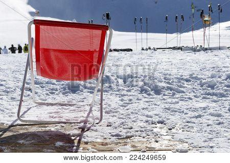 Ski poles in snow. Skiing equipment against snowy mountain in ski resort in Italy, Alps