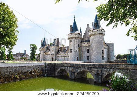 SULLY-SUR-LOIRE, FRANCE - JULY 9, 2010: view of castle Chateau de Sully-sur-Loire with bridge over moat. The fort is Renaissance castle located in town of Sully-sur-Loire in Val de Loire region