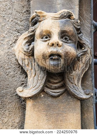 COLMAR, FRANCE - JULY 11, 2010: head sculpture on wall of Maison des Tetes (House of Heads) on Rue des Tetes in Colmar city.This house was built in 1609 by architect Hans Burge
