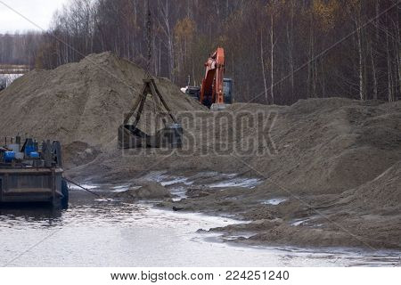 excavator in the sand mine  soil technical work yellow
