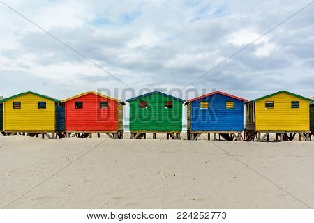 The colourful beach huts on Muizenberg beach - a popular tourist attraction near Cape Town, South Africa