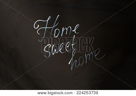 Home Sweet Home inscription on black background.