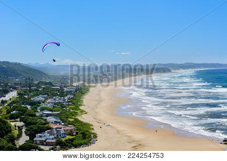 Paragliding over Wilderness beach on the Garden Route, South Africa