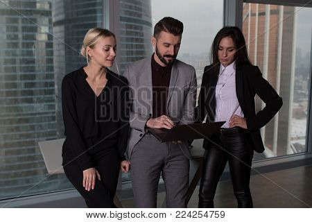 Business people work in a team for a laptop.