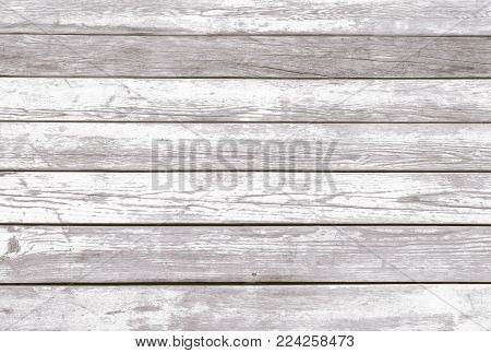 Natural Rustic Old Wood Board Shabby Background. Wooden Vintage Style Boardwalk Texture. Wood Surface Sundeck with Peeling White Paint. Horizontal Image Copy Space