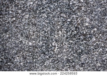 Natural stone grey granite background. Facing material granite texture. Grey granitic background texture. Hard gray granite rock texture. Grey granite stone background texture. Grey granitic surface