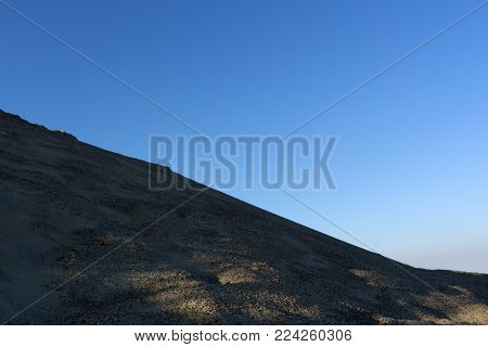 Sand dunes on blue sky background dune brown dry