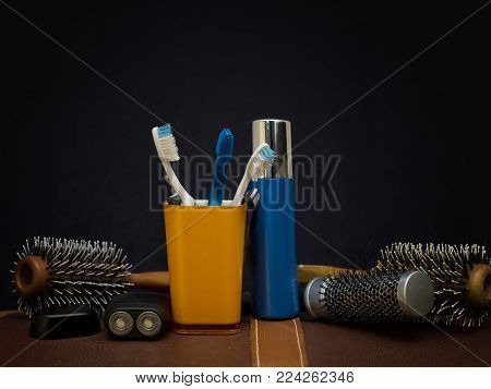 Bunch of toothbrushes, toiletries and hairbrushes, studio closeup