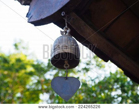 A Small Brass Bell Hanging on the Roof