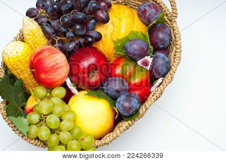 Healthy food Concept Composition with Vegetables and Fruits in Rustic Basket