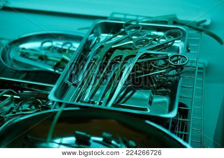 Set Of Sterile Medical Instruments In Clinic Or Hospital. Medicine, Surgery, Emergency Concept