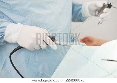 Doctor Performing Surgery On A Patient In Operation Room. Instruments For Laparoscopy. Surgeon Opera