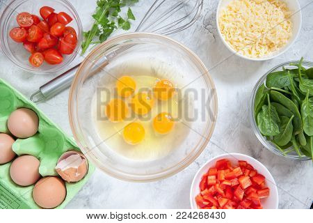 Fresh vegetables, eggs and cheese. Ingredients for healthy breakfast omelet