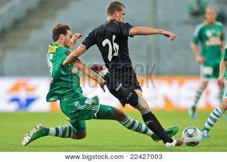 VIENNA,  AUSTRIA - JULY 26 Atdhe Nuhiu (#15, Rapid)  and Pardo (#26, Valencia) fight for the ball during the friendly soccer game on July 26, 2011 in Vienna, Austria. SK Rapid wins 4:1.