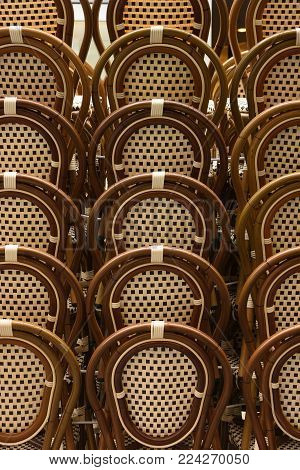 Row Of Chairs. Cafe Chairs Backs Of Classic Design Oval Shape Stacked In Rows.