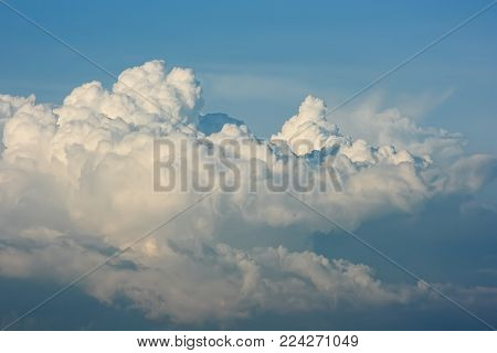 Cloudscape. White cumulus clouds are like a snow-covered mountain peaks.